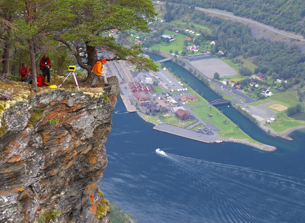 Figure 1: Norway is known for its natural beauty that attracts millions of tourists every year . However, the beauty is formed by mountain building and mountain degrading processes that include landslides. These processes present a threat to society that has a hazard (magnitude of the event and its likelihood) that can interfere with the normal life of society (vulnerability), resulting in the risk of the event to society. This threat has to be understood so that the society can adapt to the threats by prevention, mitigation and/or increasing coping capacity.